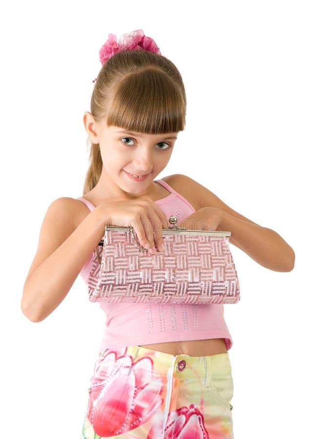A menina com uma bolsa cor-de-rosa imagem de stock