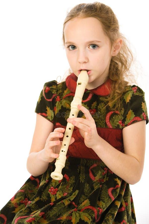 Menina com uma flauta fotografia de stock