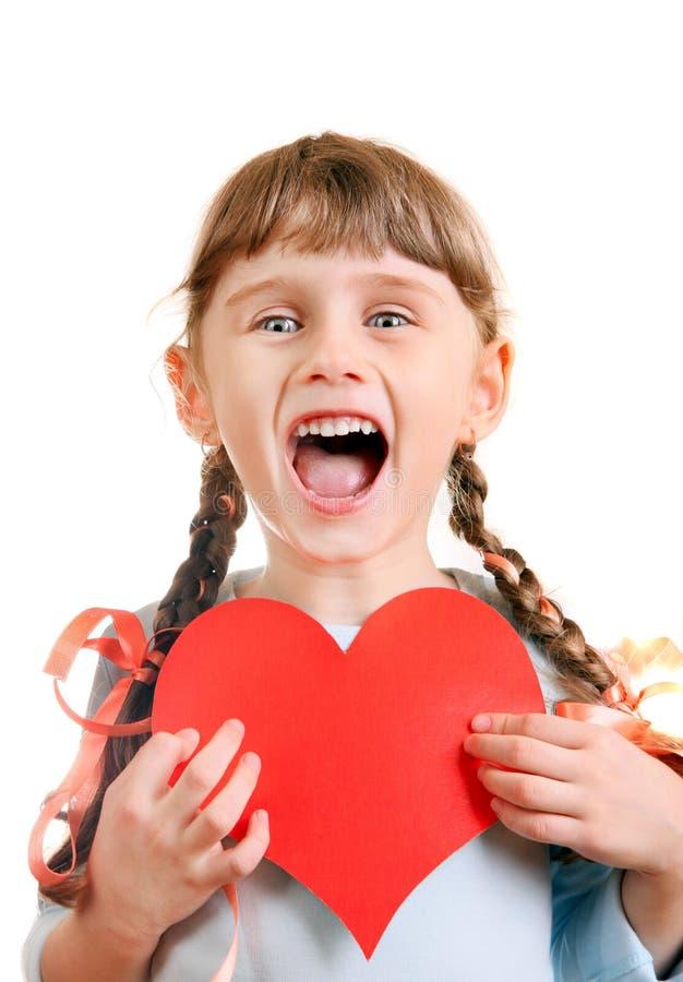 Menina com uma forma do coração fotografia de stock royalty free