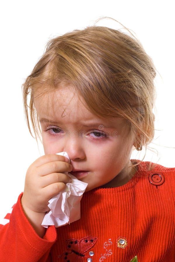 Menina com uma gripe severa foto de stock