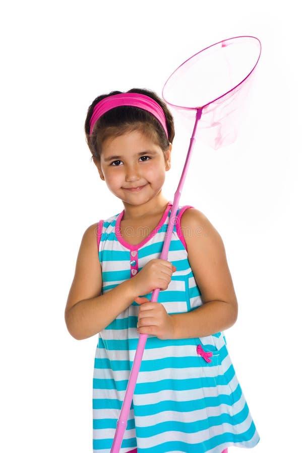 Menina com uma rede da borboleta imagem de stock royalty free