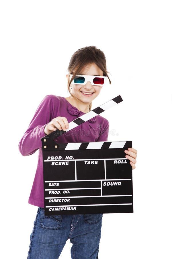 Menina com vidros 3D e uma ripa foto de stock