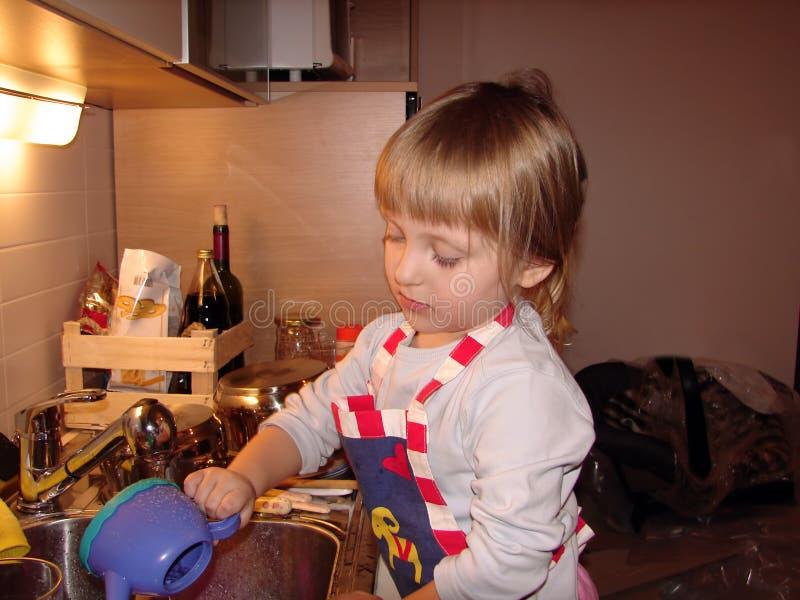 Menina como um cozinheiro foto de stock royalty free