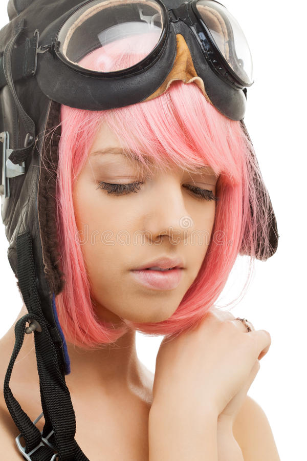 Menina cor-de-rosa do cabelo no capacete do aviador imagens de stock