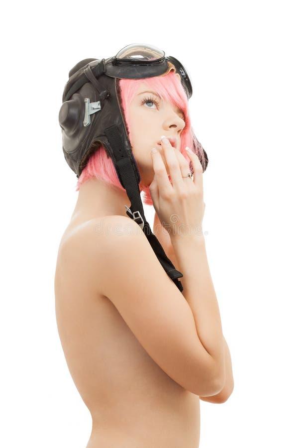 Menina cor-de-rosa em topless do cabelo no capacete do aviador imagem de stock