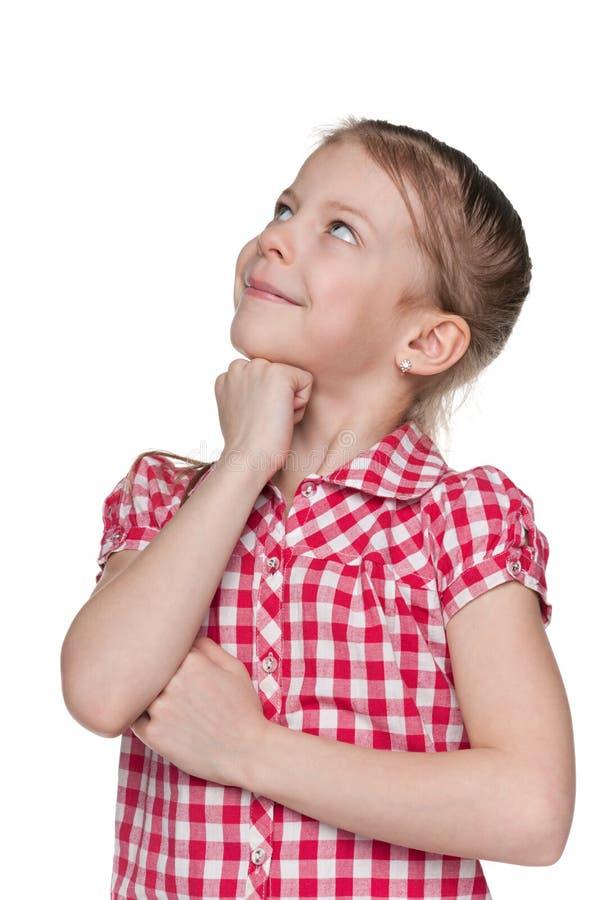 Menina curiosa no fundo branco fotos de stock