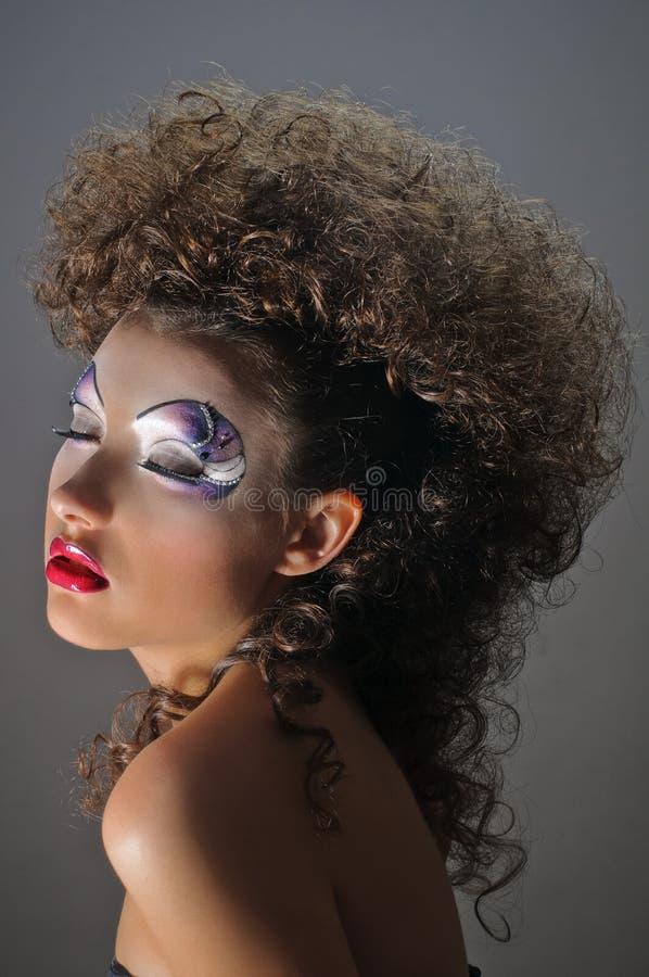 Menina curly queimada fotografia de stock