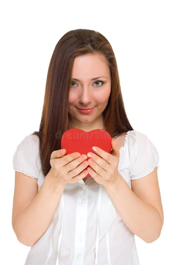 Download A Menina Dá O Coração Vermelho Imagem de Stock - Imagem de affectionate, facial: 12806577