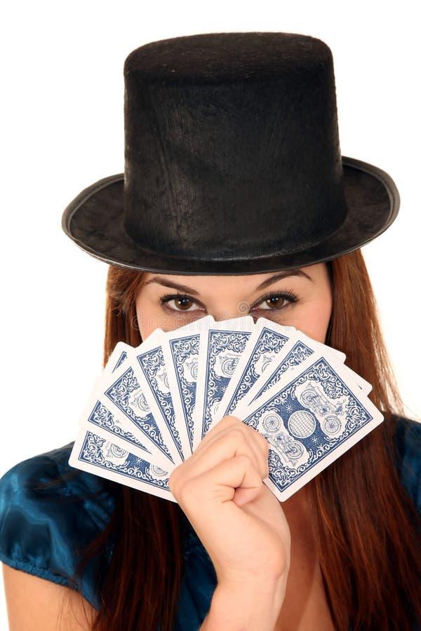 Menina da beleza no chapéu com cartões fotografia de stock royalty free