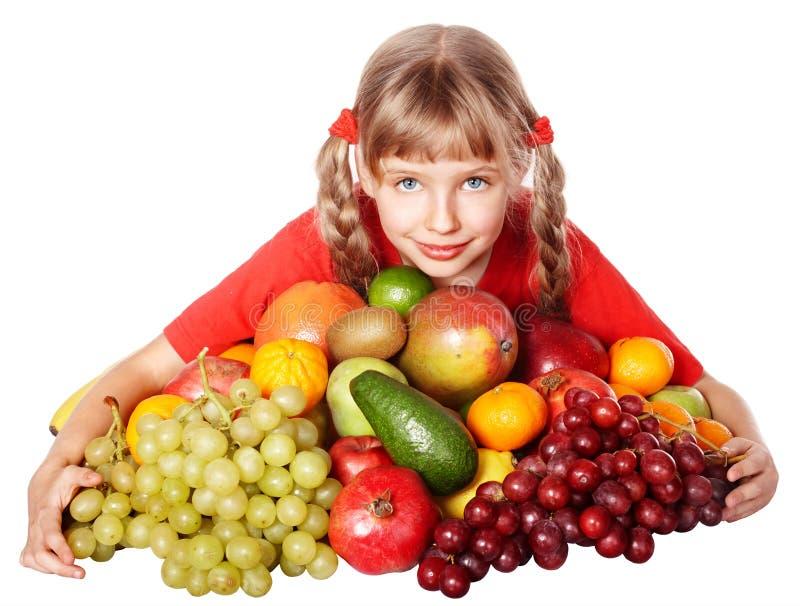 Menina da criança com grupo de fruta. fotos de stock royalty free