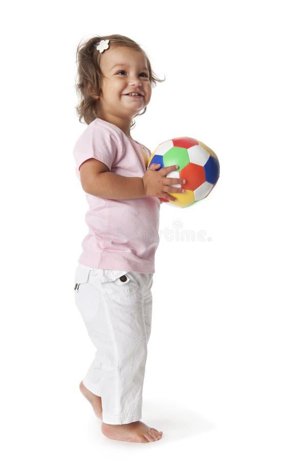 Menina da criança com uma esfera colorida foto de stock