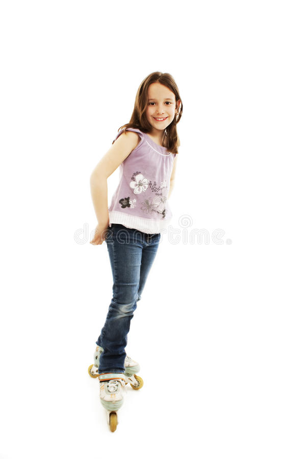Menina da criança do skater do rolo nos rolos fotos de stock