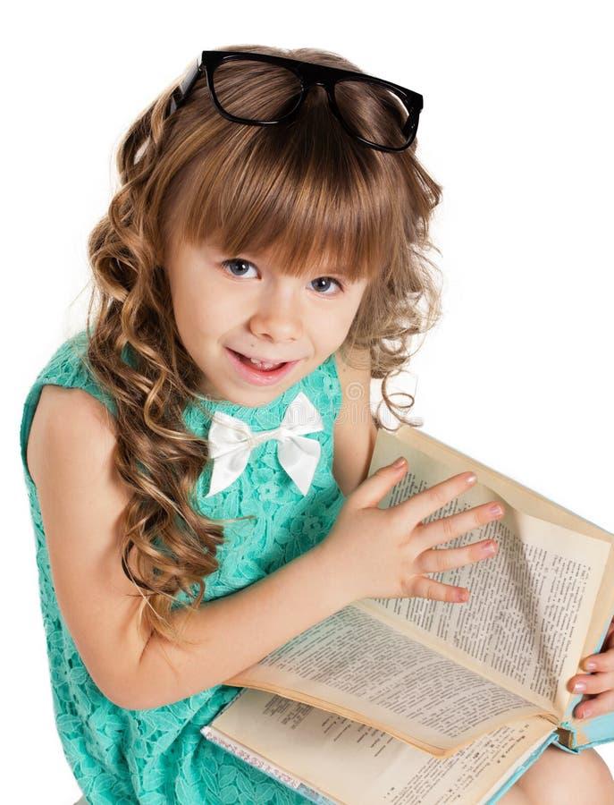 Menina da criança em idade pré-escolar com livro fotos de stock royalty free