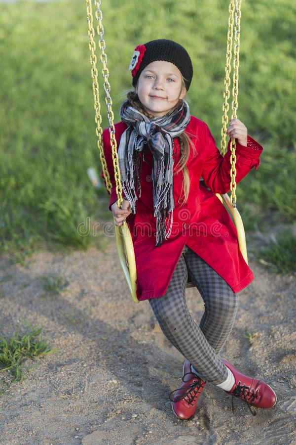 Menina da criança no balanço imagens de stock royalty free