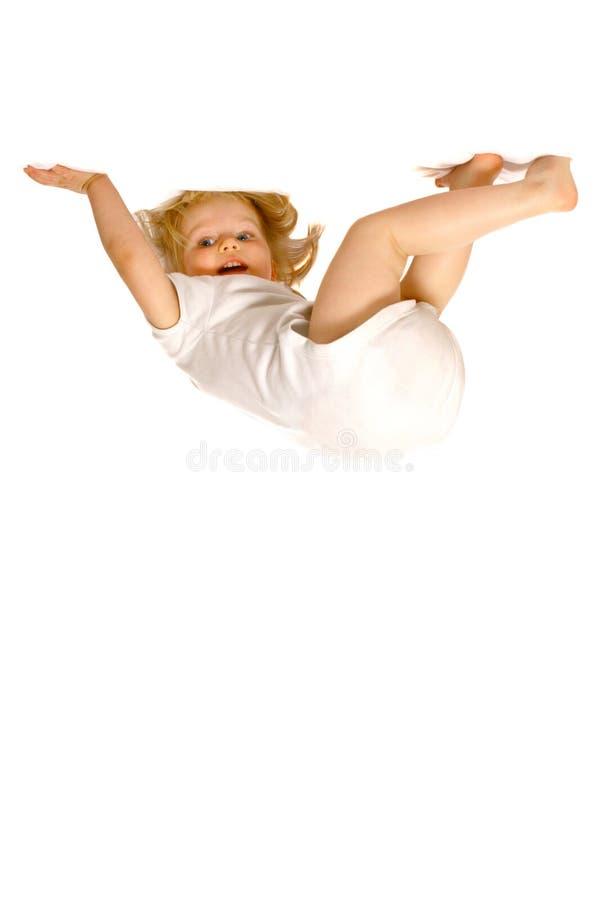 Menina da criança que pendura upside-down fotos de stock royalty free