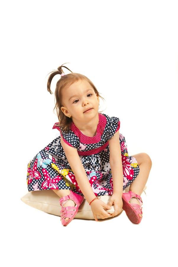 Menina da criança que senta-se no descanso imagem de stock royalty free