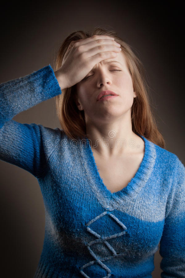 Menina da dor de cabeça fotografia de stock
