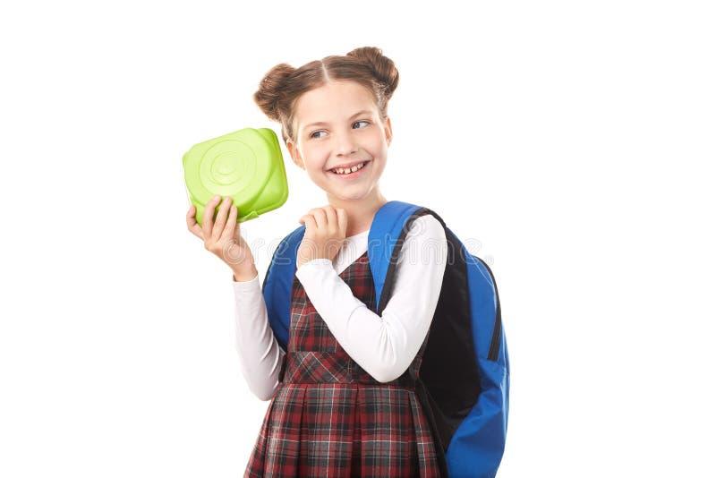 Menina da escola com cesta de comida imagem de stock