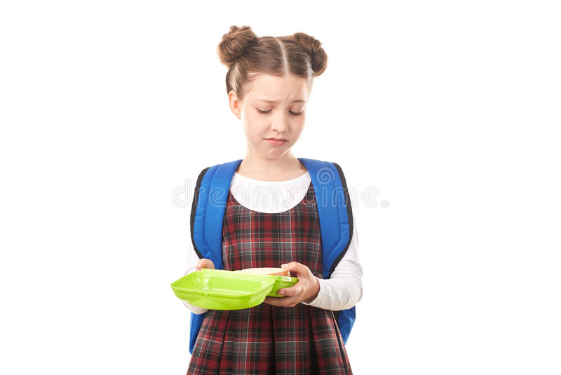 Menina da escola com cesta de comida imagem de stock royalty free