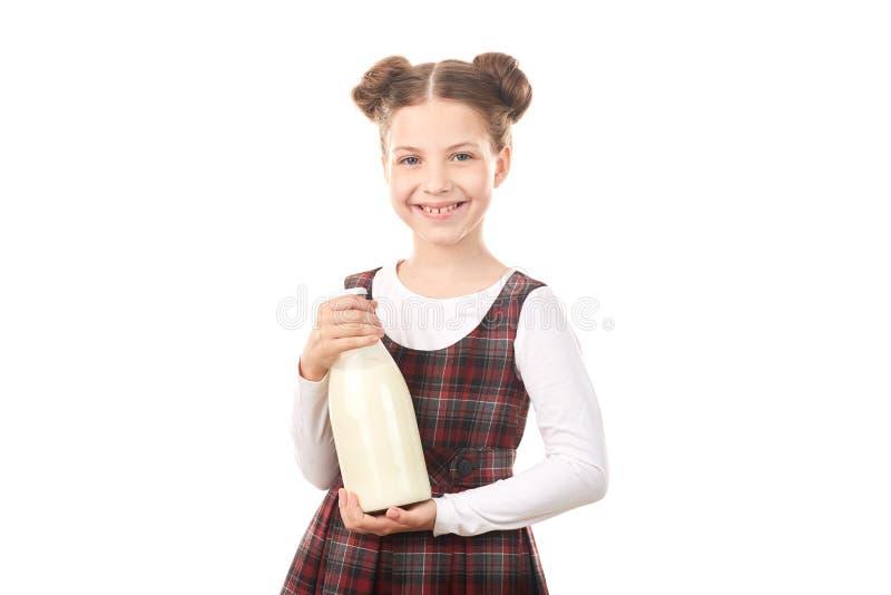 Menina da escola com garrafa de leite imagens de stock