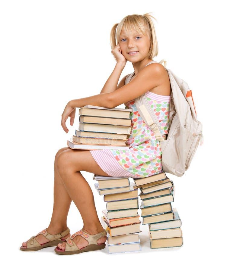 Menina da escola com livros foto de stock