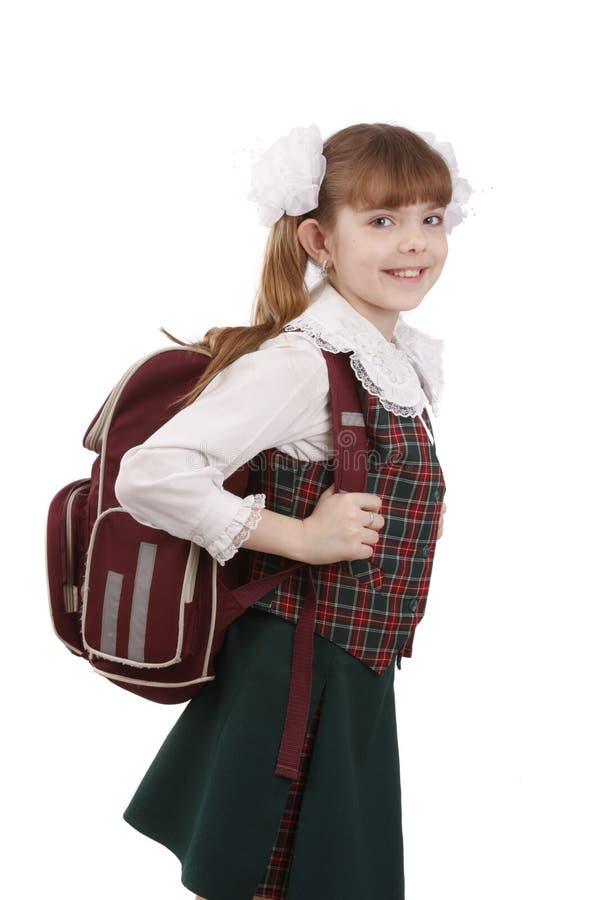 Menina da escola com schoolbag. Instrução. fotografia de stock royalty free