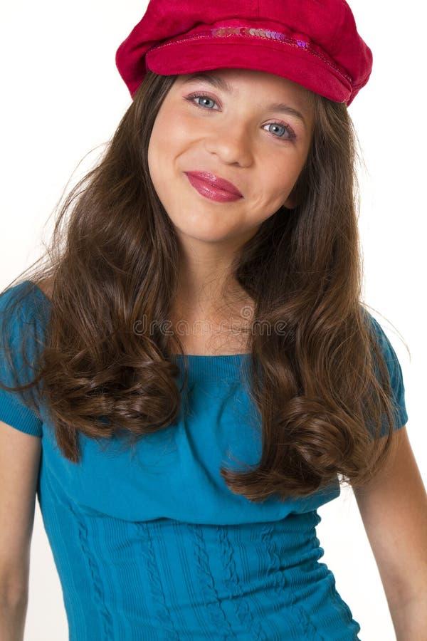 Menina da escola do Preteen com chapéu foto de stock royalty free