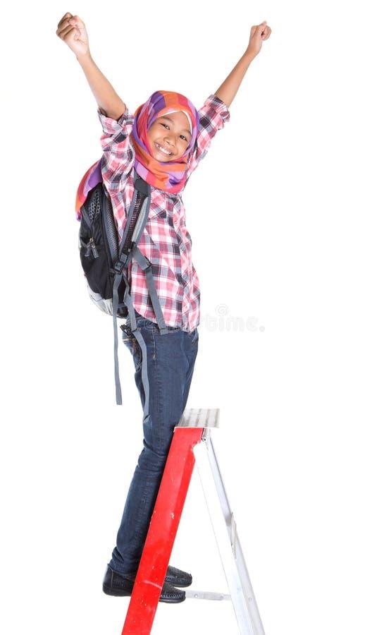 Menina da escola e escada muçulmanas IV imagens de stock