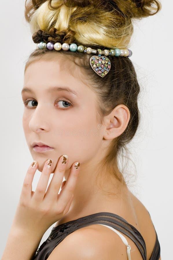 Menina da forma que mostra jóias fotografia de stock royalty free