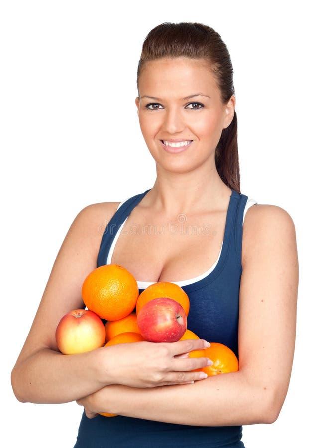 Menina da ginástica com muitas frutas fotografia de stock