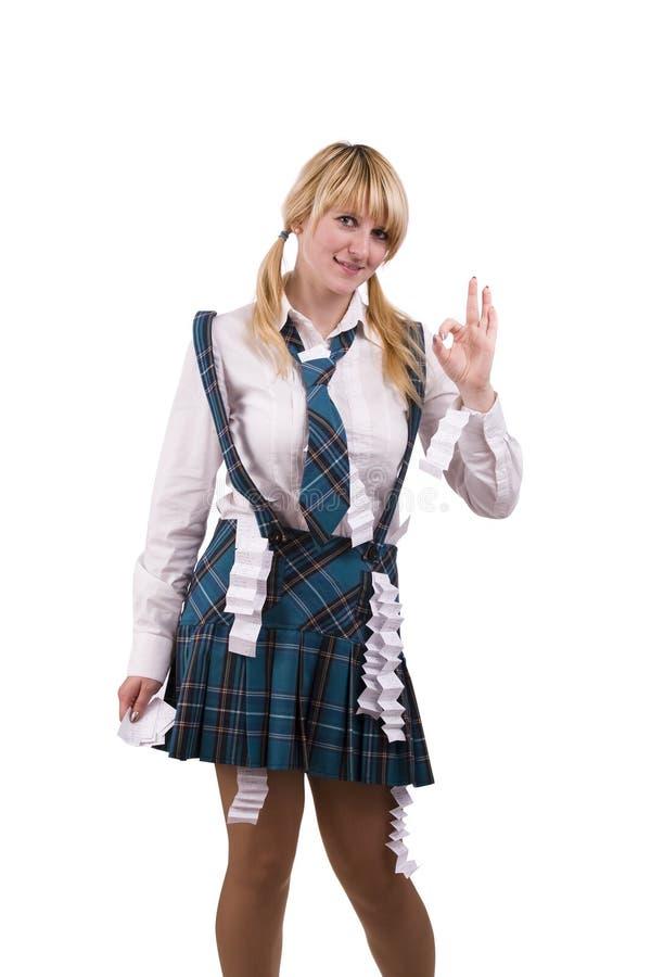 A menina da High School está escondendo a folha de ucha no uniforme. fotografia de stock