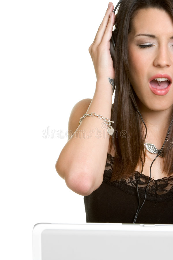 Menina da música do portátil imagens de stock royalty free