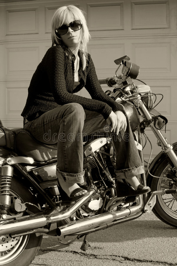 Menina da motocicleta imagens de stock