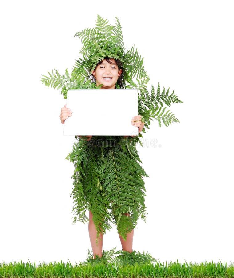 Menina da planta na grama imagens de stock