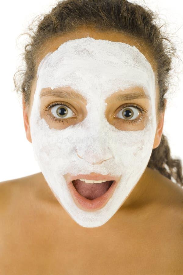 Menina da surpresa com máscara facjal imagens de stock