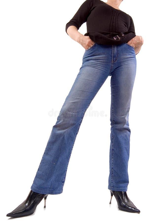 Menina das calças de brim imagem de stock