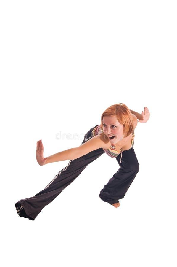 Menina de cabelo vermelha que executa exercícios da aptidão fotos de stock royalty free