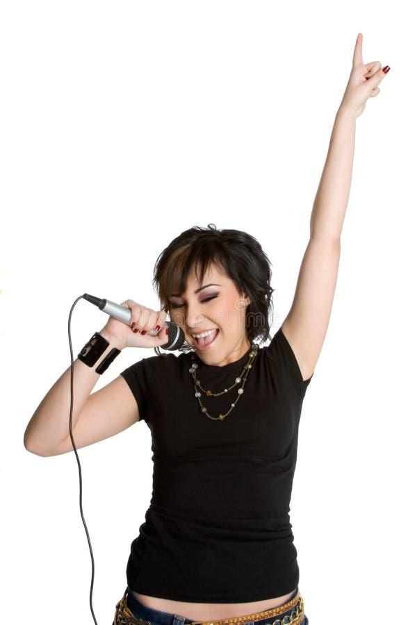 Menina de canto do microfone fotos de stock
