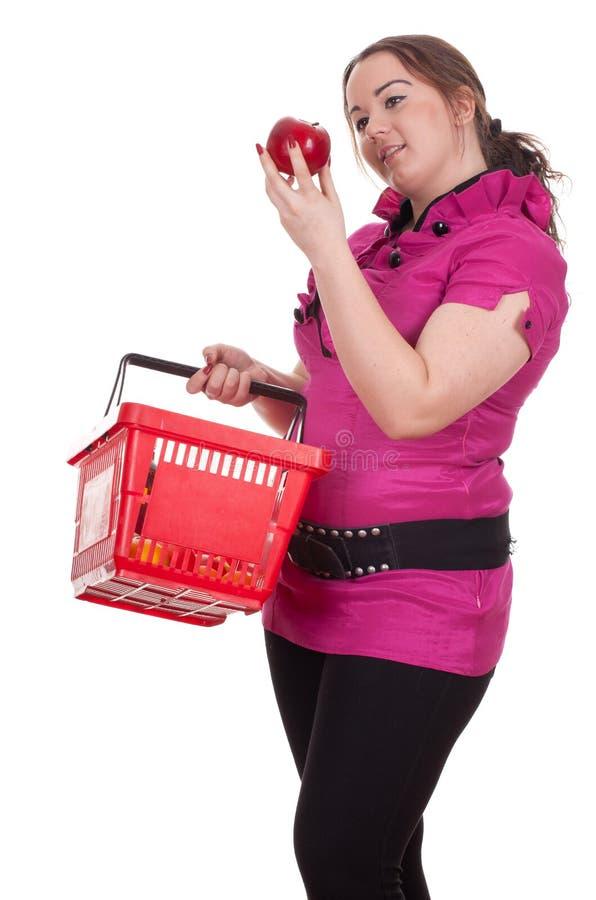 Menina de compra com maçã imagem de stock royalty free