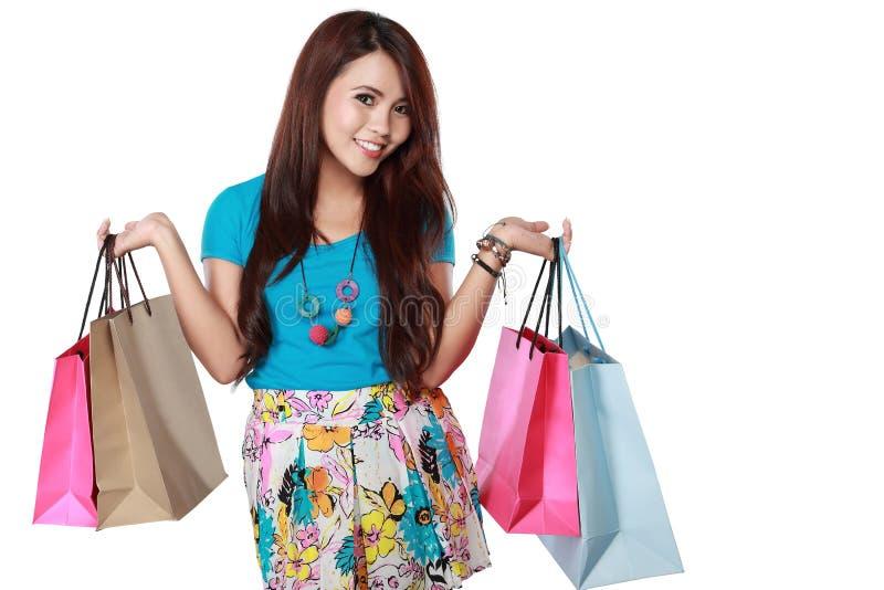Menina de compra feliz com muitos saco shoping imagem de stock