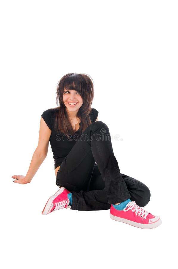 Menina de Emo que senta-se no branco imagens de stock