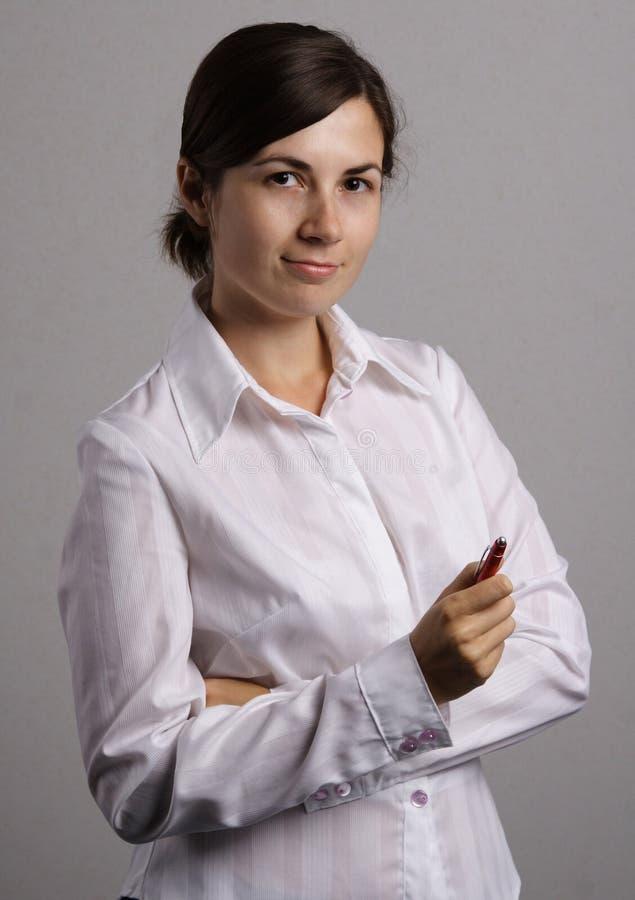 Menina de escritório e uma pena fotos de stock