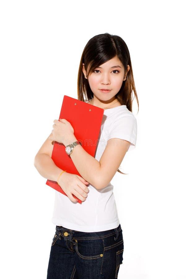 Menina de faculdade bonita com arquivo vermelho foto de stock