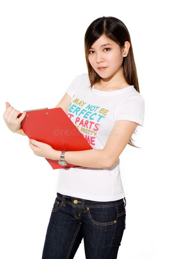 Menina de faculdade bonito com arquivo vermelho fotos de stock