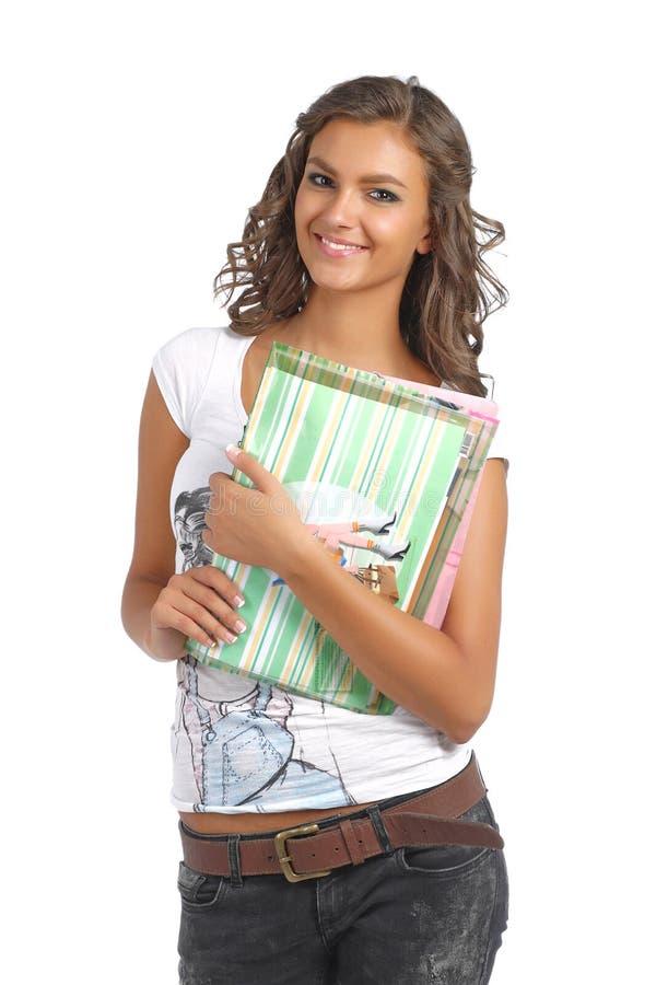 Menina de faculdade nova com livros foto de stock