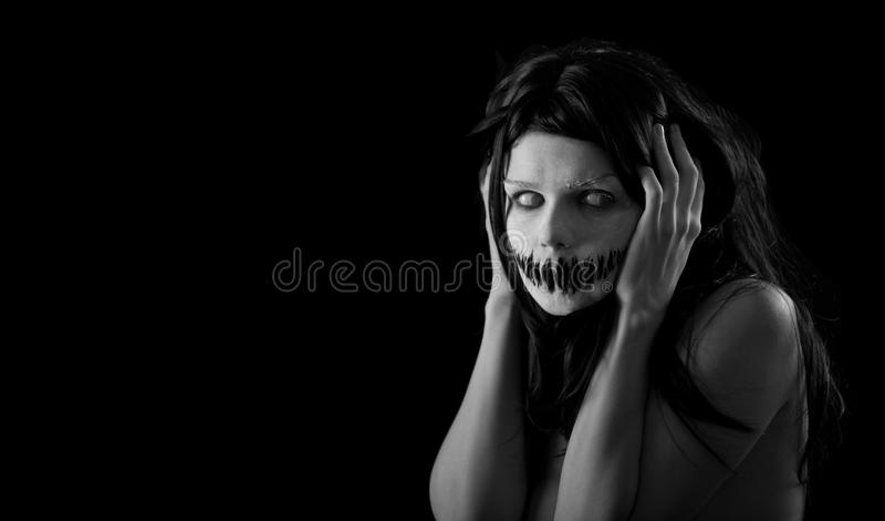 Menina de Halloween com boca assustador imagens de stock royalty free