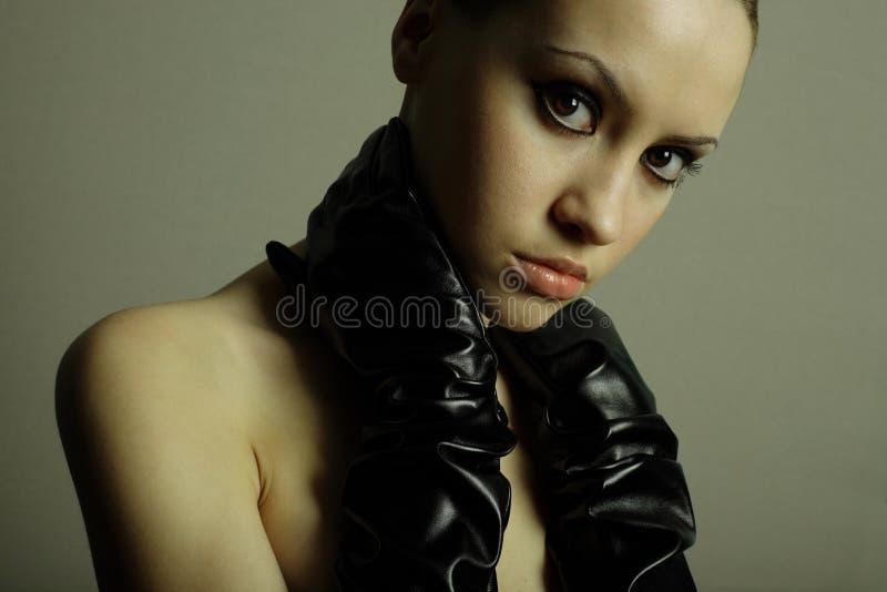 Menina de Nudel com as luvas fotos de stock royalty free