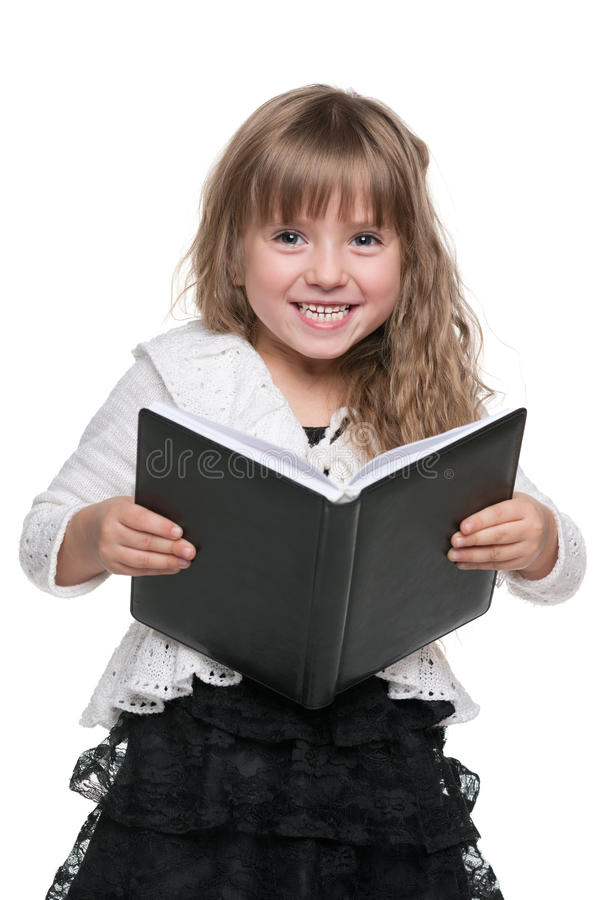 Menina de riso com um caderno fotografia de stock