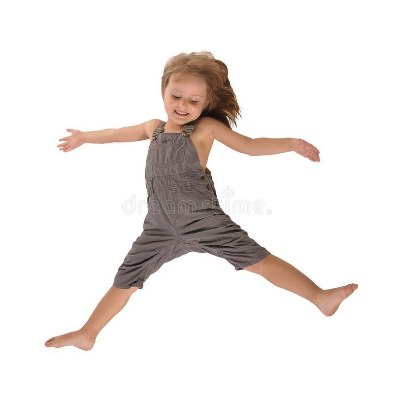 Menina de salto ativa nos rompers isolados no branco imagem de stock royalty free