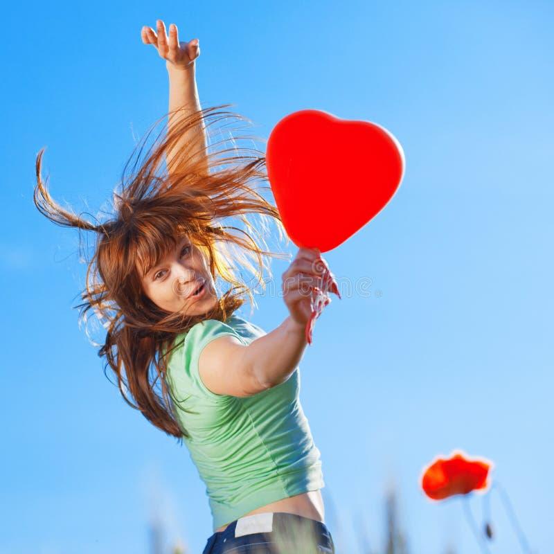 Menina de salto com coração foto de stock royalty free